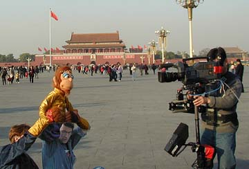 Rick Lyon and Monkey in Tienanmen Square